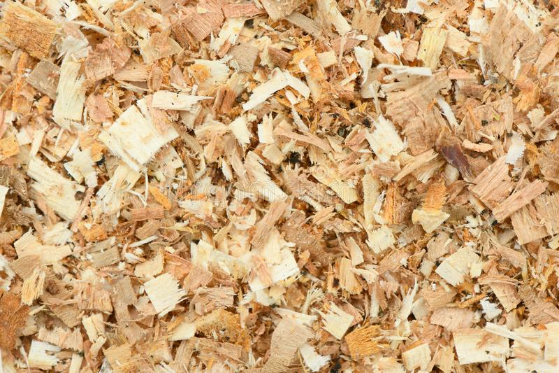 A Freshly Laid Layer of Large Garden Bark Woodchips. Woodchips used as safe soft surface in a childrens play park, Top Down View. High resolution photo. Full stock photo