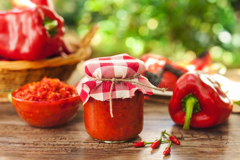 Freshly made ajvar in glass jar. On the table royalty free stock images