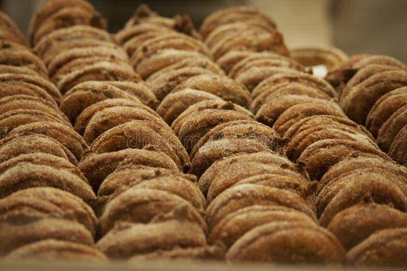 Freshly made apple cinnamon sugar donuts at an apple orchard in Indiana. Freshly made apple cinnamon sugars donuts at an apple orchard in Indiana ready to be royalty free stock image