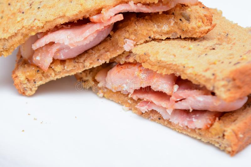 Freshly made bacon sandwich. On a white plate royalty free stock photography