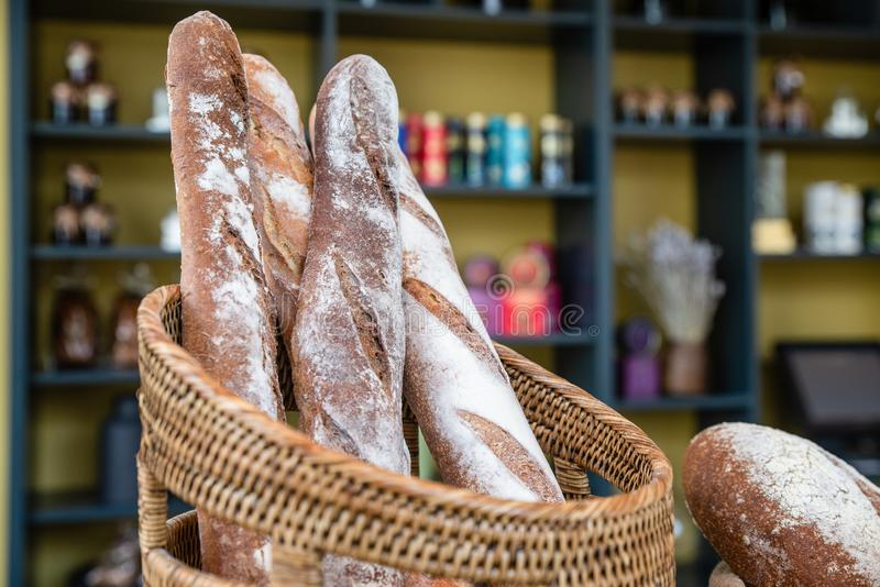Freshly made bread in bakery. Whole grain organic loaf beautiful delicious french style baguette handmade golden brown. royalty free stock photo