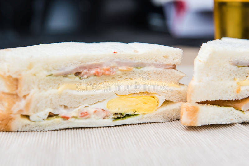 Freshly made Club sandwich and Juice on a cloth stock photography