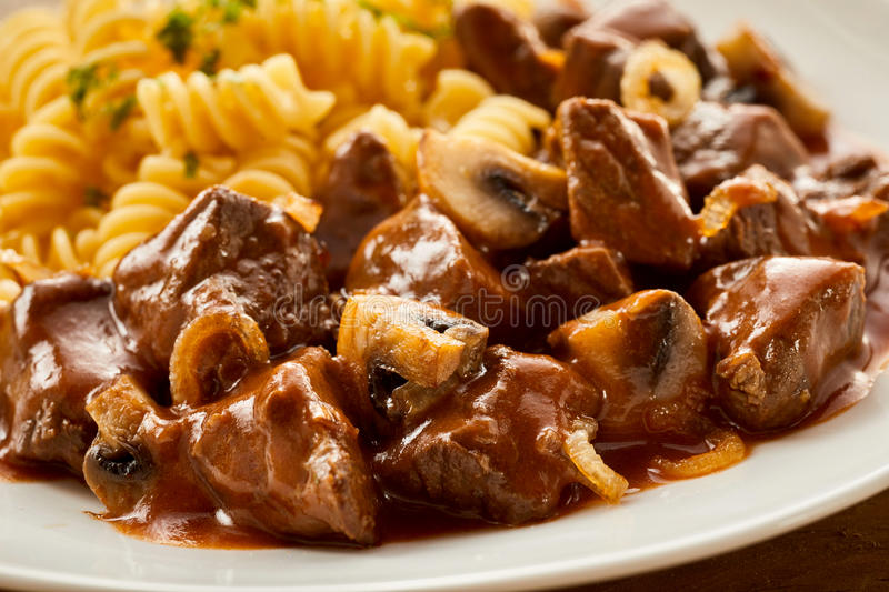 Freshly made Hungarian goulash with pasta stock images
