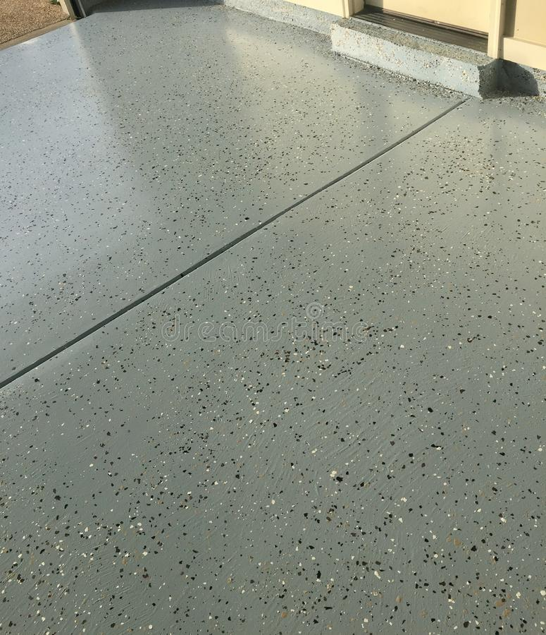 Garage Floor Paint. Freshly painted automotive car garage, painted with garage floor paint epoxy and finished with a premium grade clear-coat royalty free stock photography