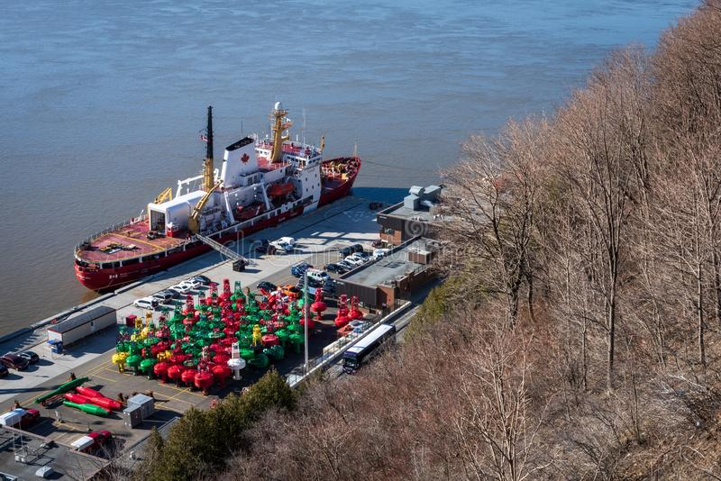 Freshly painted colorful buoys awaiting springtime deployment. royalty free stock image