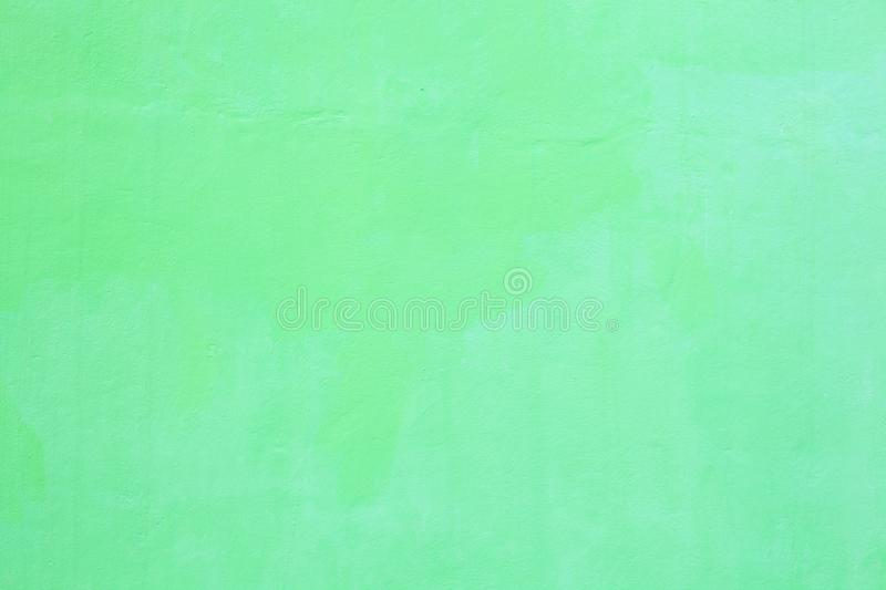 Freshly painted light green colored plain seamless grunge textured plastered rough wall background in rustic Asian house. Home royalty free stock photos