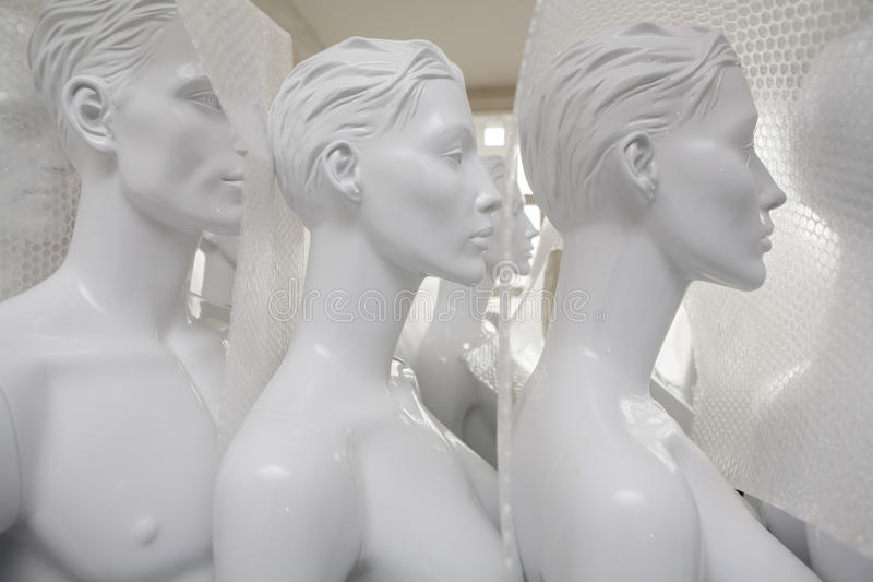 Freshly painted mannequins packed to be sent out stock images