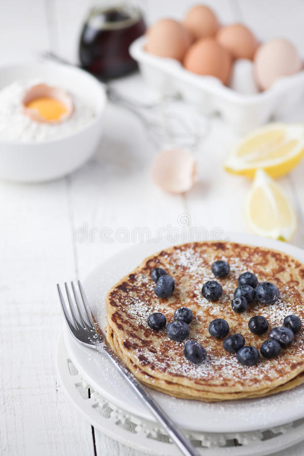 Freshly prepared crepes with blueberries stock photo