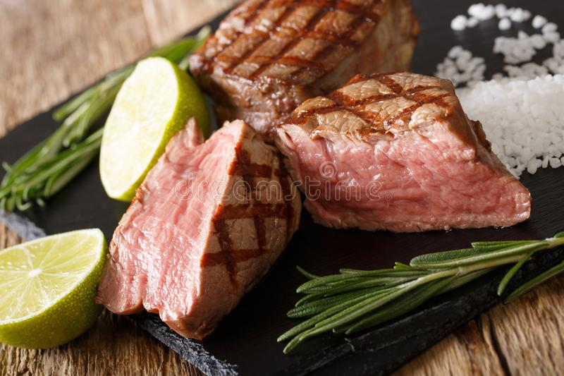 Freshly prepared fillet mignon steak sliced close-up on a cutting board. horizontal royalty free stock photo