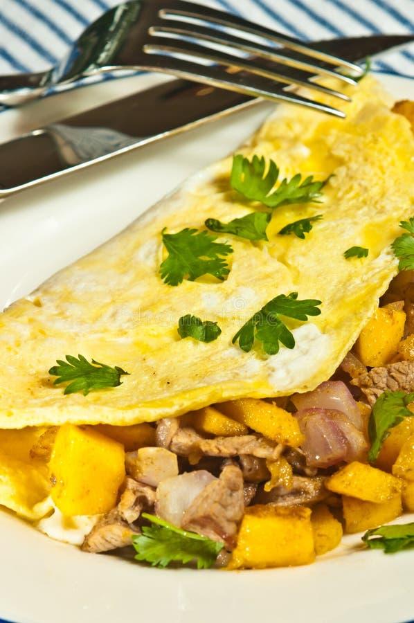 Freshly prepared, homemade, pork and mango omelet pork. Top view, close up of a freshly prepared, homemade, pork and mango omelet stock photography