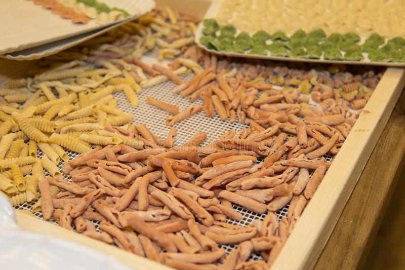 Freshly Prepared Raw Coloured Pasta in a Food Store.  stock photo