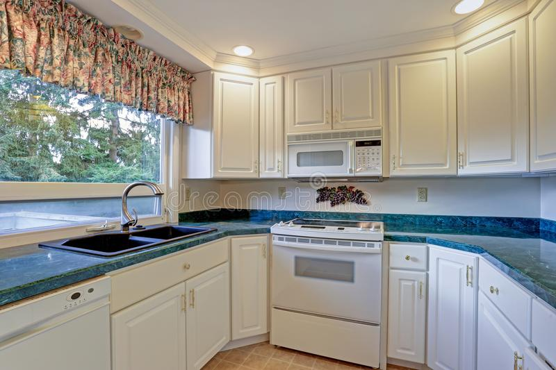 Freshly renovated kitchen room with white cabinetry royalty free stock images