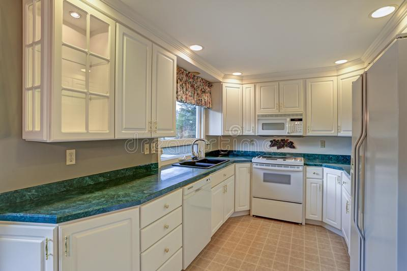 Freshly renovated kitchen room with white cabinetry stock image