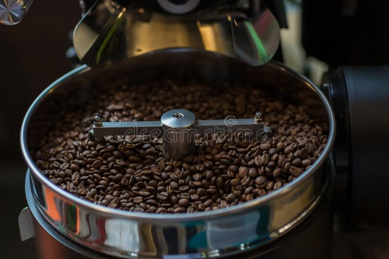 Freshly roasted aromatic coffee beans in a modern coffee roasting machine. Fresh Coffee Beans - Freshly roasted spinning cooler pr royalty free stock photos