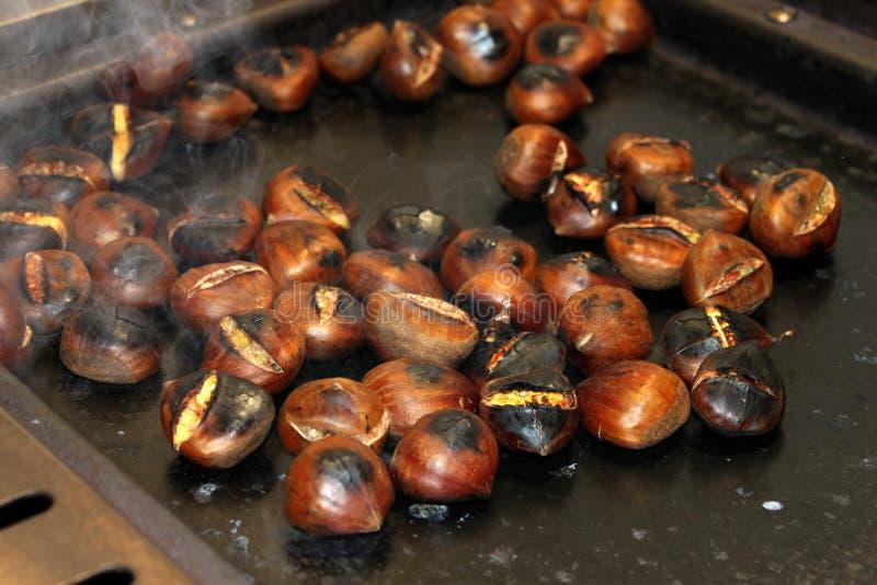 Freshly roasted chestnuts stock images