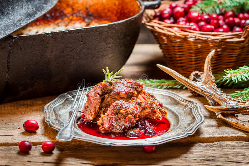 Freshly served venison with cranberries and rosemary royalty free stock photography