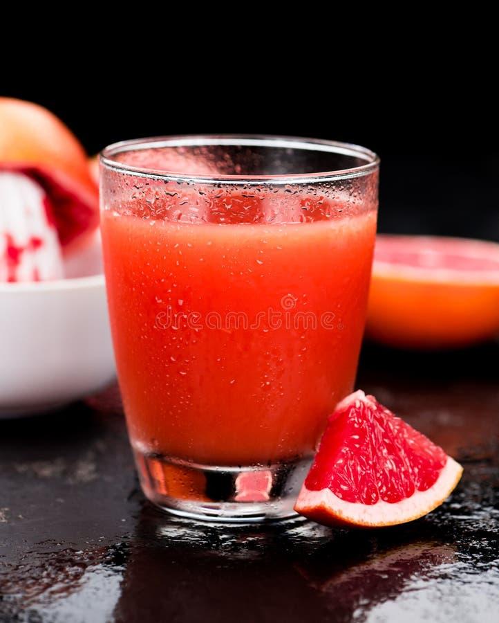 Freshly squeezed Grapefruit Juice selective focus stock photos