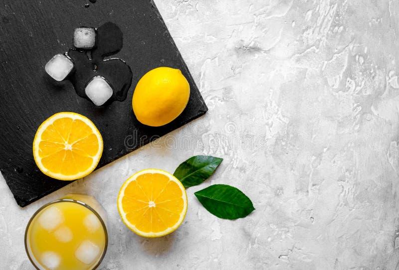 Freshly squeezed orange juice on concrete background top view.  stock photo