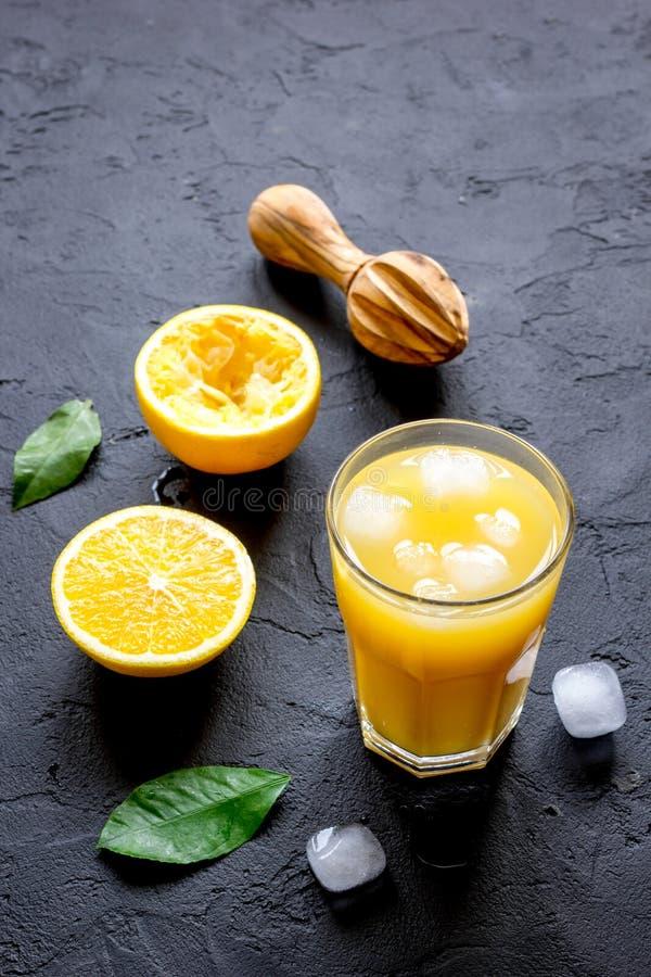 Freshly squeezed orange juice on dark background. Close up royalty free stock image