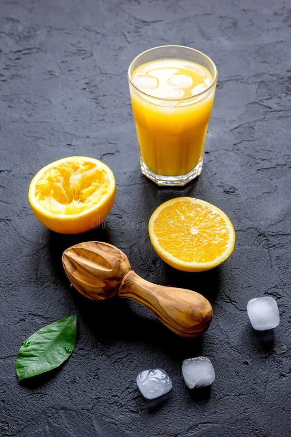 Freshly squeezed orange juice on dark background. Close up royalty free stock photos
