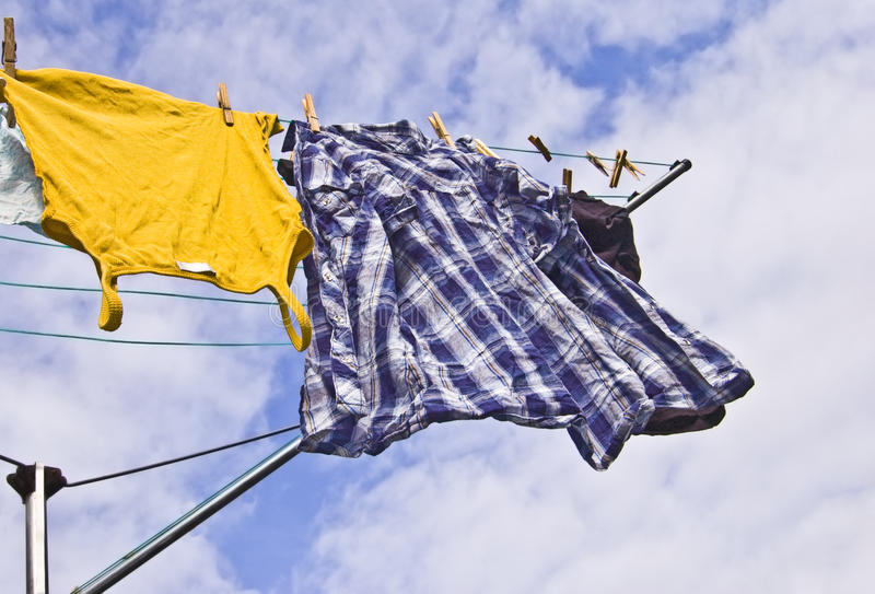 Download Freshly Washed Clothes Hang Out To Dry On A Sunny Stock Image - Image: 13023769