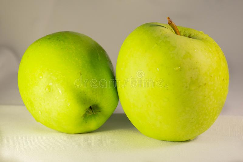 Fresh apples with water drops royalty free stock image