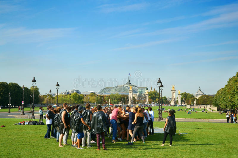 Freshmen Hazing Paris France. A group of students doing hazing rituals (bizutage in French) to the freshmen. The Grand Palais and the Petit Palais are to be seen stock images