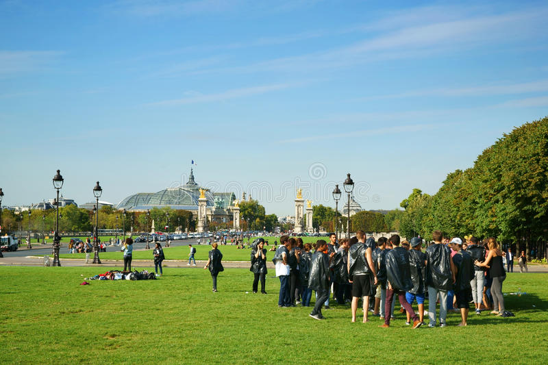 Freshmen Hazing Paris France. A group of students doing hazing rituals to the freshmen (named bizutage in French). The Grand Palais and the Petit Palais are to stock photos
