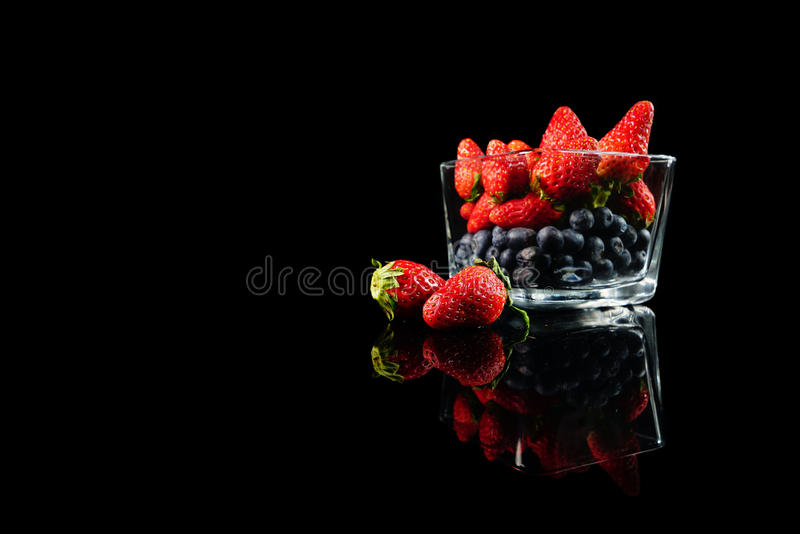 Freshness of strawberries and blueberries stock images