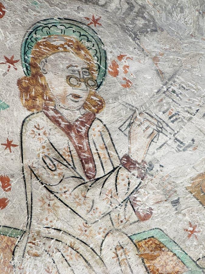 Fresko die van Heilige Matthew met beschermende brillen, zijn evangelieboek samenstellen royalty-vrije stock afbeelding