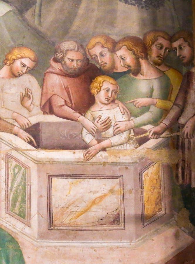 Fresko in San Gimignano - Jesus geworfen in den Brunnen stockfotografie