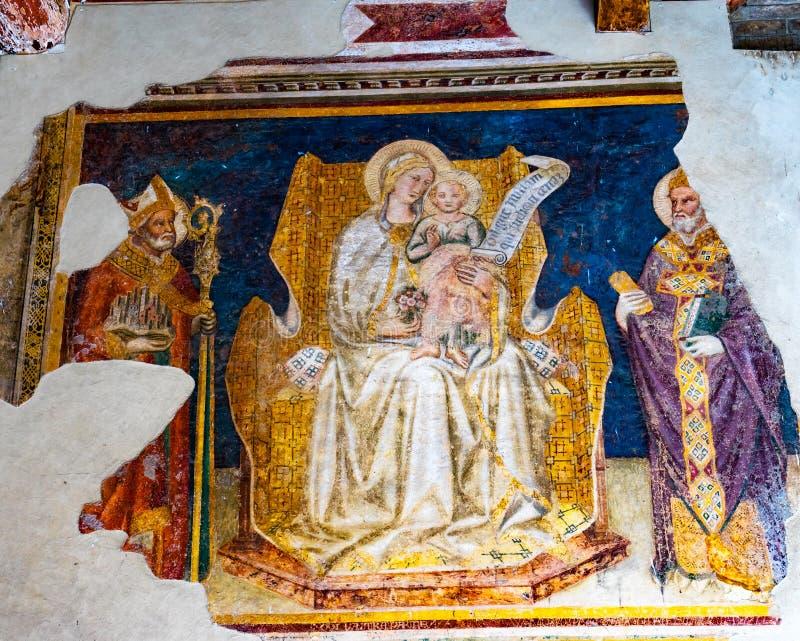Freskomålning San Gimignano Tuscany Italien för madonnabarnhelgon arkivbilder