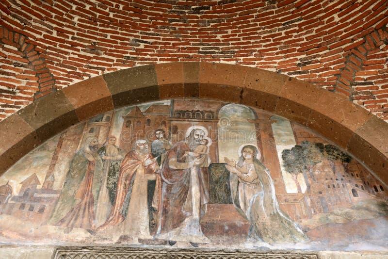 Freskos über Tür Heiligem Gayane Church lizenzfreie stockfotografie