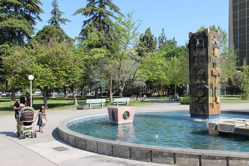Fresno. UNITED STATES - APRIL 12, 2014: People walk in a park in , California.  is the 5th most populous city in California (509 thousand citizens royalty free stock photography