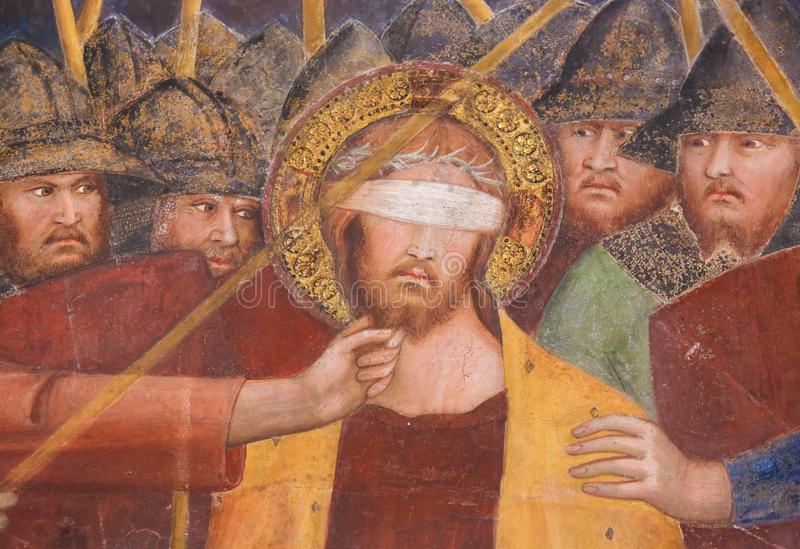 Fresque à San Gimignano - Jésus a bandé les yeux photographie stock