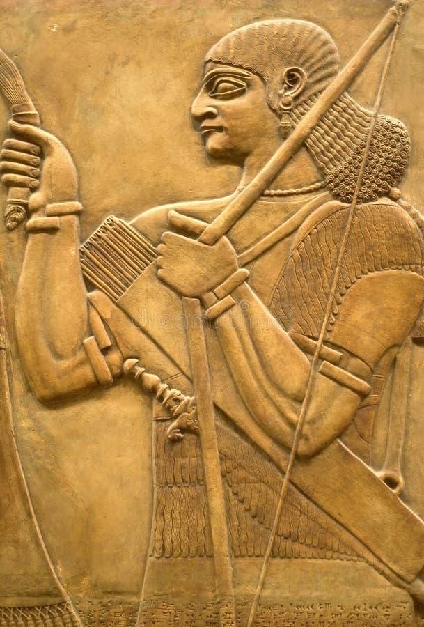 Fresque assyrien sur le mur photo stock