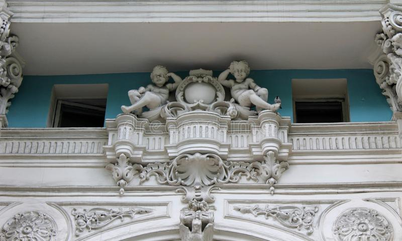 Fretwork angels on the building. In Odessa, Ukraine royalty free stock image