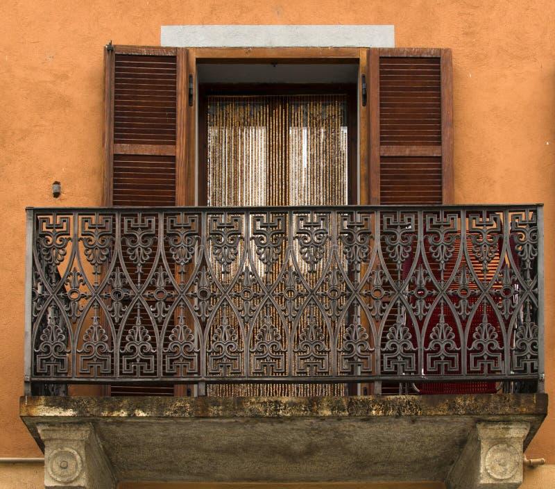 A fretwork balcony on the antic house of Italy.  stock photos