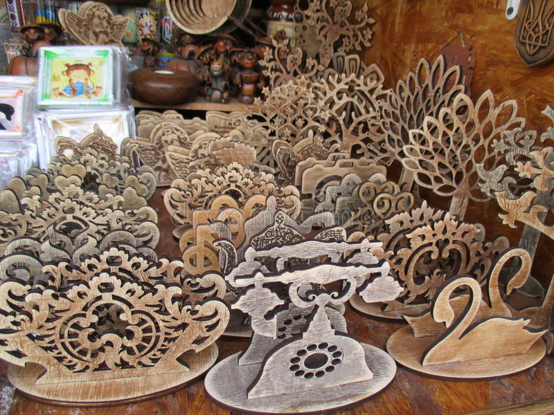 Fretwork goods, Kamenets Podolskiy, Ukraine. Shopboard with home made fretwork goods stock photography