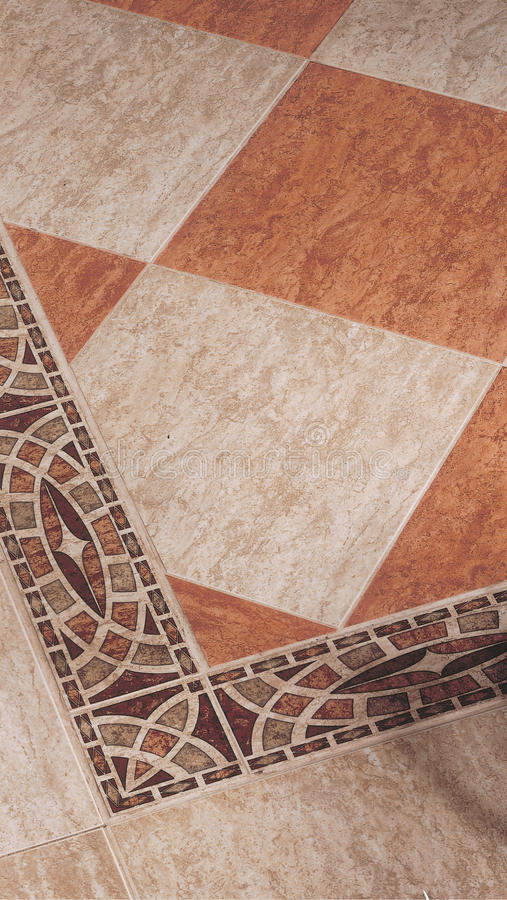 Fretwork tile brown, red and beige. Greek roman style royalty free stock photo
