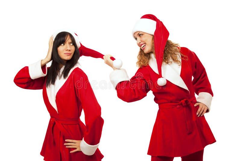 Freundinnen im Sankt-Kostüm lizenzfreies stockbild