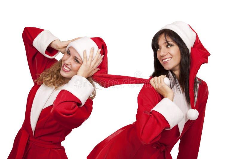 Freundinnen im Sankt-Kostüm lizenzfreies stockfoto