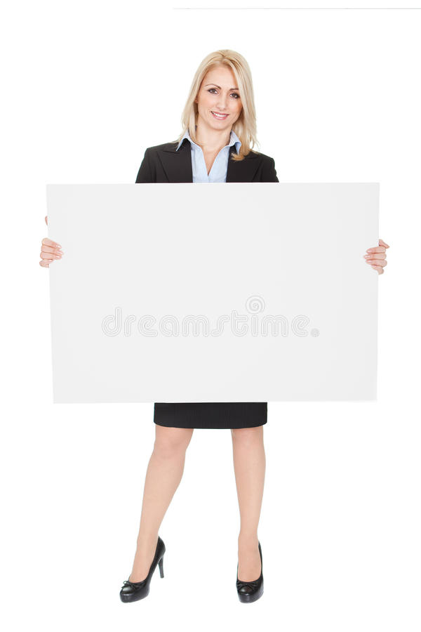 Freundliche Geschäftsfrauen, die leeren Vorstand darstellen lizenzfreie stockfotos