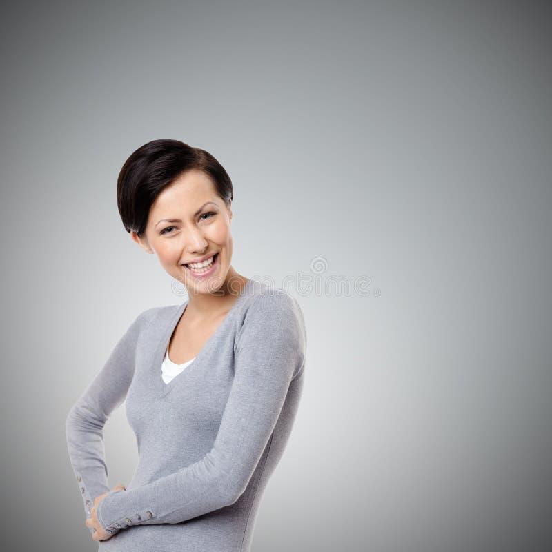 Freundliche junge Frau stockfoto