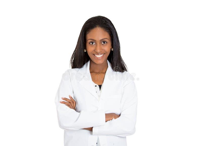 Freundlicher, lächelnder überzeugter weiblicher Heilberufler lizenzfreie stockfotos