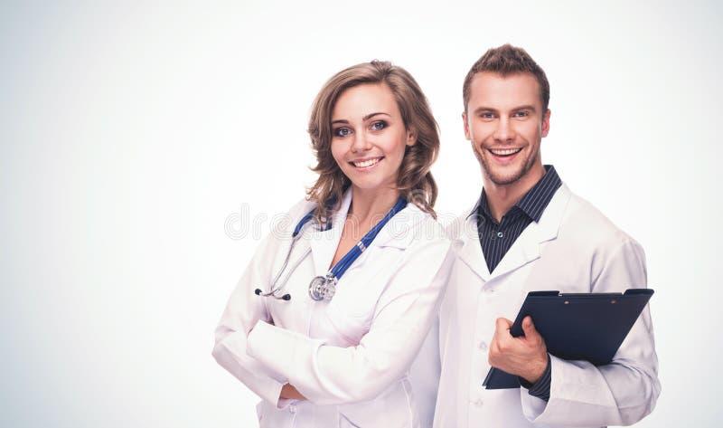 Freundlicher lächelnder Mann und Ärztinnen lizenzfreies stockfoto