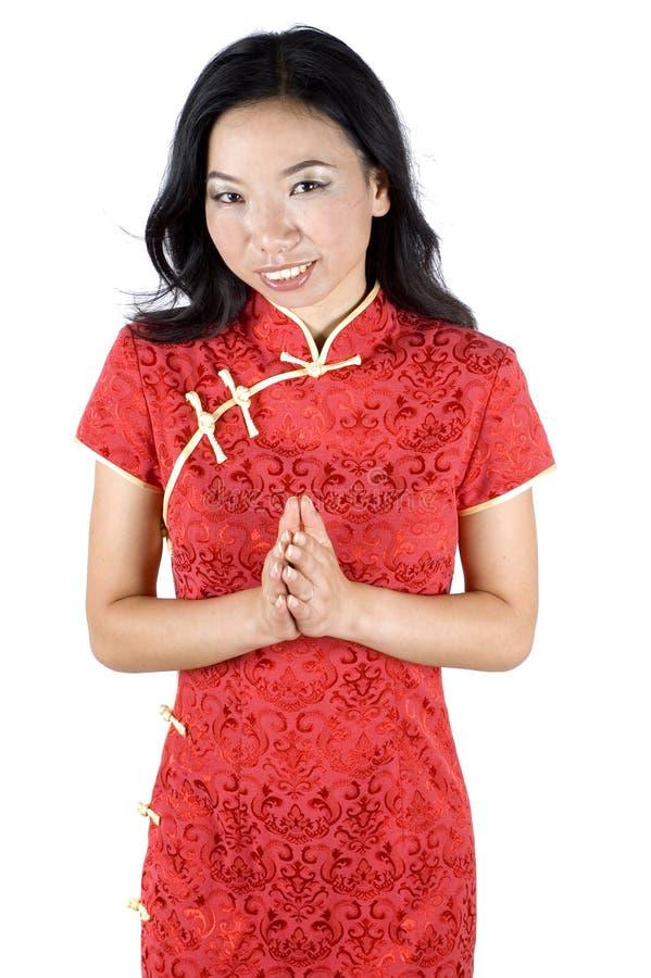 Freundliches chinesisches Mädchen mit Handgeste stockbild