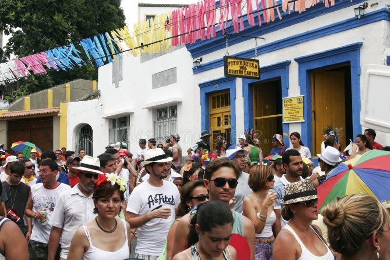 Frevo carnival in Olinda in Brasil. OLINDA, PERNAMBUCO/ BRASIL – 19 FEBRUARY 2012 – People dancing on the street during the frevo carnival in the royalty free stock images