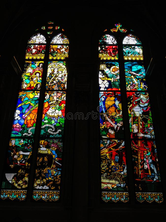 Fribourg, Switzerland - June 26, 2012: Stained Glass Windows created by the Polish painter, Jozef Mehoffer, between 1896 and 1936. Is located in St. Nicolas royalty free stock photo