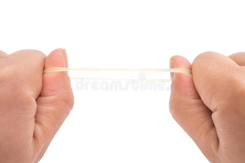 Fricción de un elástico con las manos con la trayectoria de recortes imagenes de archivo